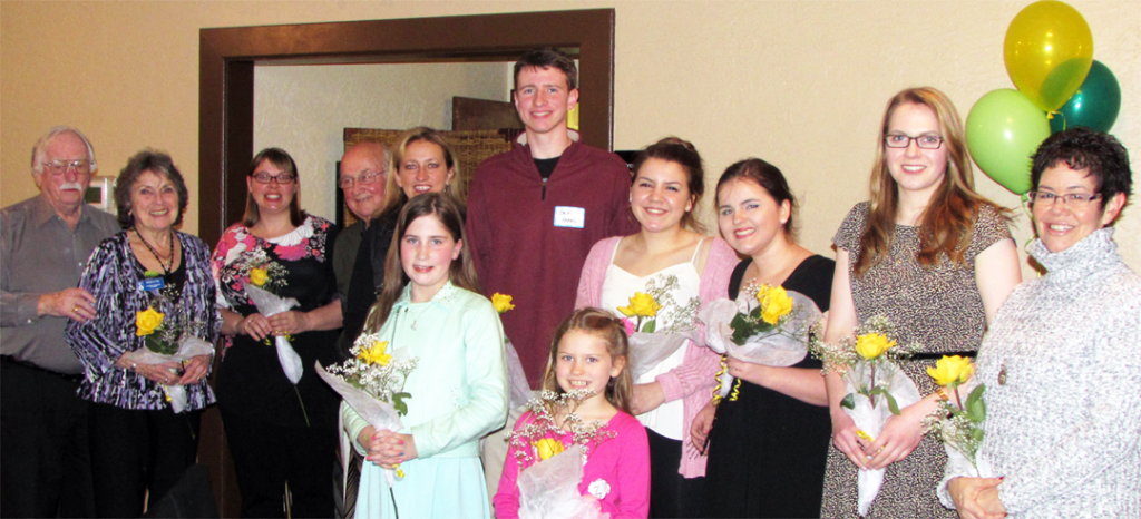 Back row, L to R: Stanley and Marilyn Frey, Victoria Last, Willy Christmas, Holly Christmas, Zach Harris, Sofie Thulen, Olivia Hanstad, Jillian Bruce, and Rebecca Larsen. In Front, L to R: Juliette Scott and Kaylan Dawson. (Not pictured: Kasey Swanson)