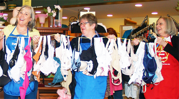 "Soroptimist La Conner members with some of the hundreds of bras collected for the ""Free The Girls"" organization."